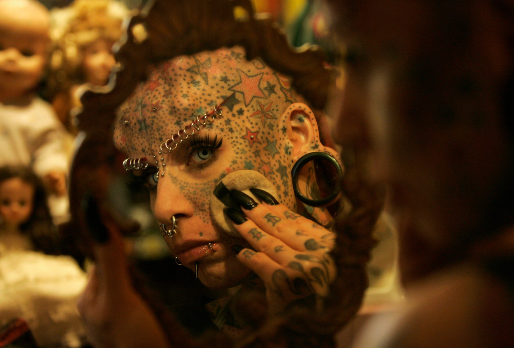 . Maria Jose Cristerna, 36, a mother of four, tattoo artist and former lawyer, applies make-up to her face at her home in Guadalajara February 7, 2012. REUTERS/Alejandro Acosta