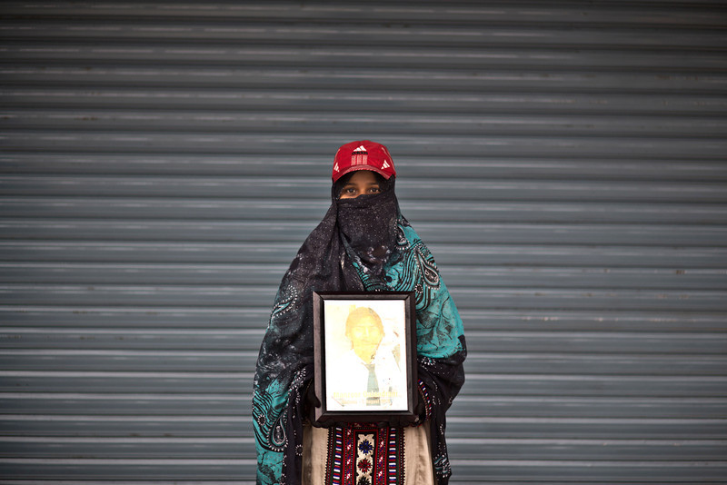 . Zareena Qalandrani poses for a portrait holding a photograph of her brother Manzoor, who went missing on August 2, 2012, while she and other relatives take a break from a long march protest, in Rawalpindi, Pakistan, Friday, Feb. 28, 2014. She is part of a group of activists from the impoverished southwestern province of Baluchistan who walked roughly 3,000 kilometers (1,860 miles) to the capital of Islamabad to draw attention to alleged abductions of their loved ones by the Pakistani government. (AP Photo/Muhammed Muheisen)