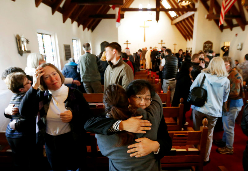 Description of . People embrace each other during a service in honor of the victims who died a day earlier when a gunman open fire at Sandy Hook Elementary School in Newtown, Conn., as people gathered at St. John's Episcopal Church , Saturday, Dec. 15, 2012, in the Sandy Hook village of Newtown, Conn.  The massacre of 26 children and adults at Sandy Hook Elementary school elicited horror and soul-searching around the world even as it raised more basic questions about why the gunman, 20-year-old Adam Lanza, would have been driven to such a crime and how he chose his victims. (AP Photo/Julio Cortez)
