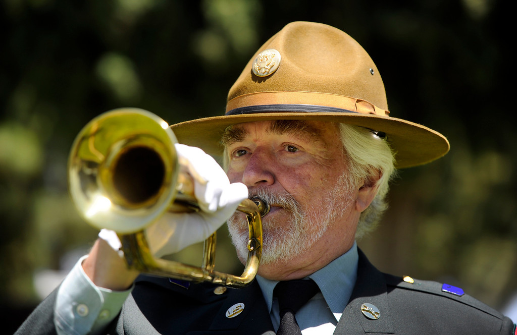 . Dressed in his Army uniform from when he served from 1968-73, Frank Dorritie plays taps at the Union Cemetery on Thursday, May 23, 2013, in Brentwood, Calif. (Susan Tripp Pollard/Bay Area News Group)