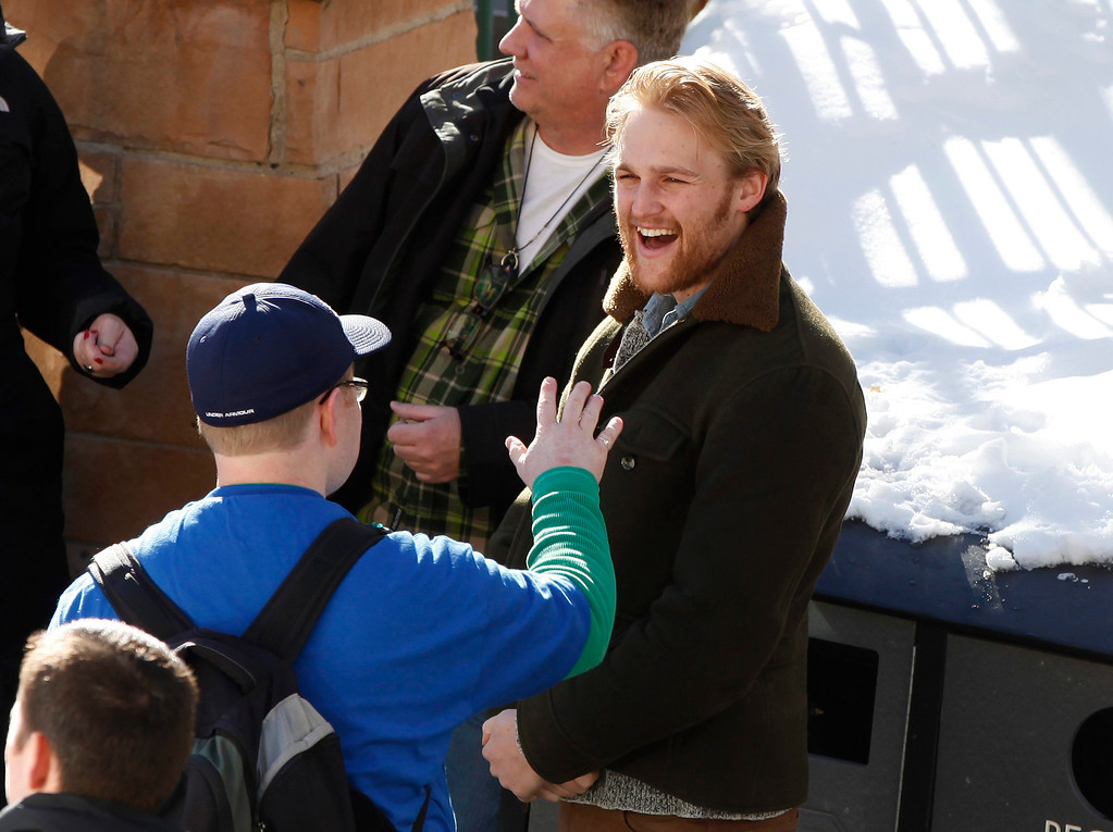 . Actor Wyatt Russell talks to people along Main Street during the Sundance Film Festival in Park City, Utah, January 18, 2013.  REUTERS/Jim Urquhart