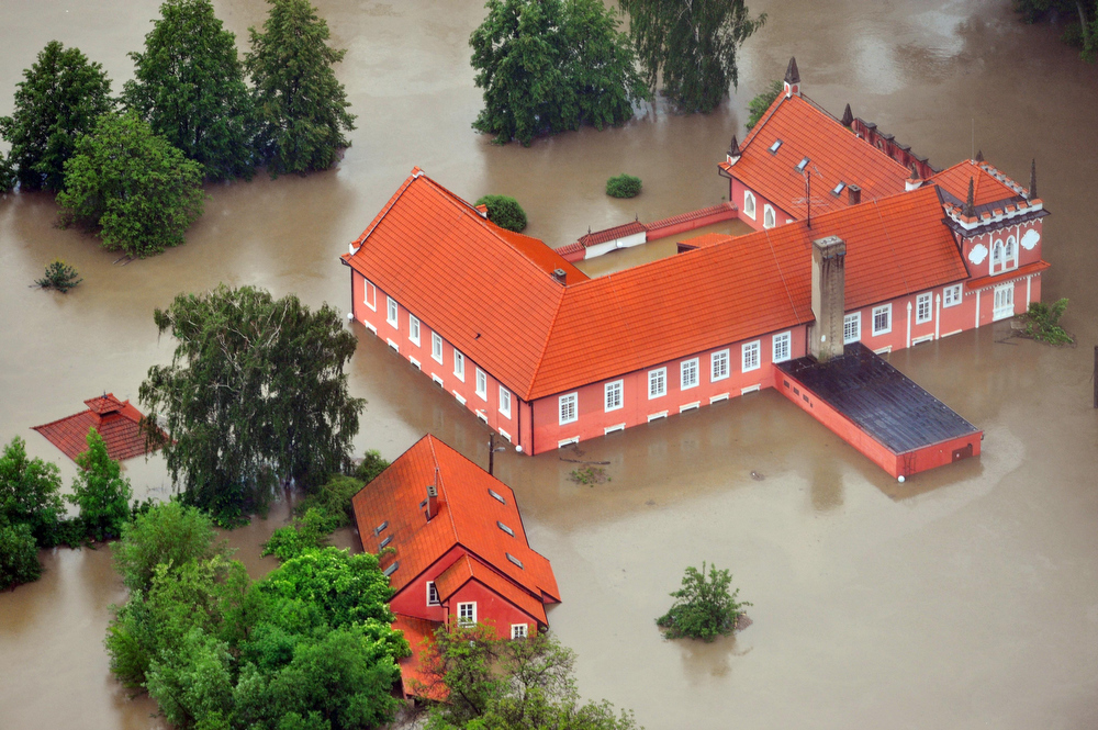 . Aerial view of the swollen Vltava river¥s flooded Red Mill at chateau park in Veltrusy, about 35 km (21.7) north of Prague, on Monday, June 3, 2013. Heavy rainfalls cause flooding along rivers and lakes in Germany, Austria, Switzerland and the Czech Republic. (AP Photo/CTK, Vit Simanek)