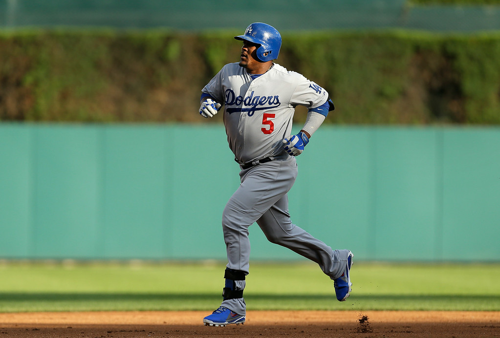 . Los Angeles Dodgers\' Juan Uribe rounds the bases after hitting a two-run home run against the Detroit Tigers in the first inning of a baseball game in Detroit, Tuesday, July 8, 2014. (AP Photo/Paul Sancya)