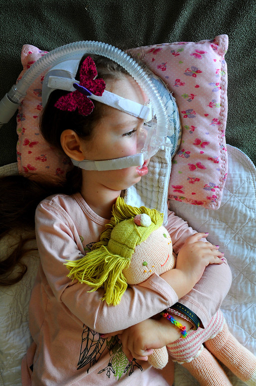 . Gwendolyn Strong lays with her doll on a sofa and watches television in their Santa Barbara home. (Photo by Michael Owen Baker/Los Angeles Daily News)
