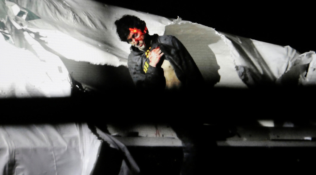 . In this Friday, April 19, 2013 Massachusetts State Police photo, 19-year-old Boston Marathon bombing suspect Dzhokhar Tsarnaev leans over in a boat at the time of his capture by law enforcement authorities in Watertown, Mass.   (AP Photo/Massachusetts State Police, Sean Murphy)