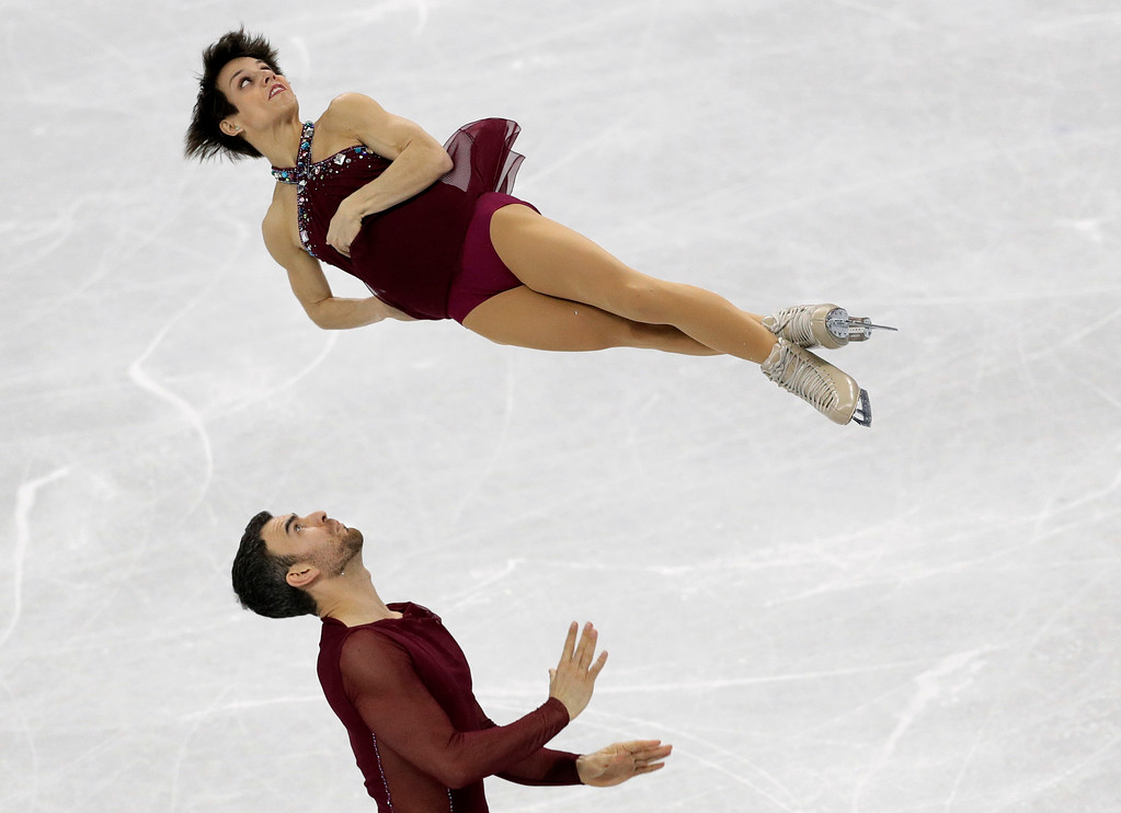 . Meagan Duhamel and Eric Radford, of Canada, perform in the pairs free skate figure skating final in the Gangneung Ice Arena at the 2018 Winter Olympics in Gangneung, South Korea, Thursday, Feb. 15, 2018. (AP Photo/David J. Phillip)
