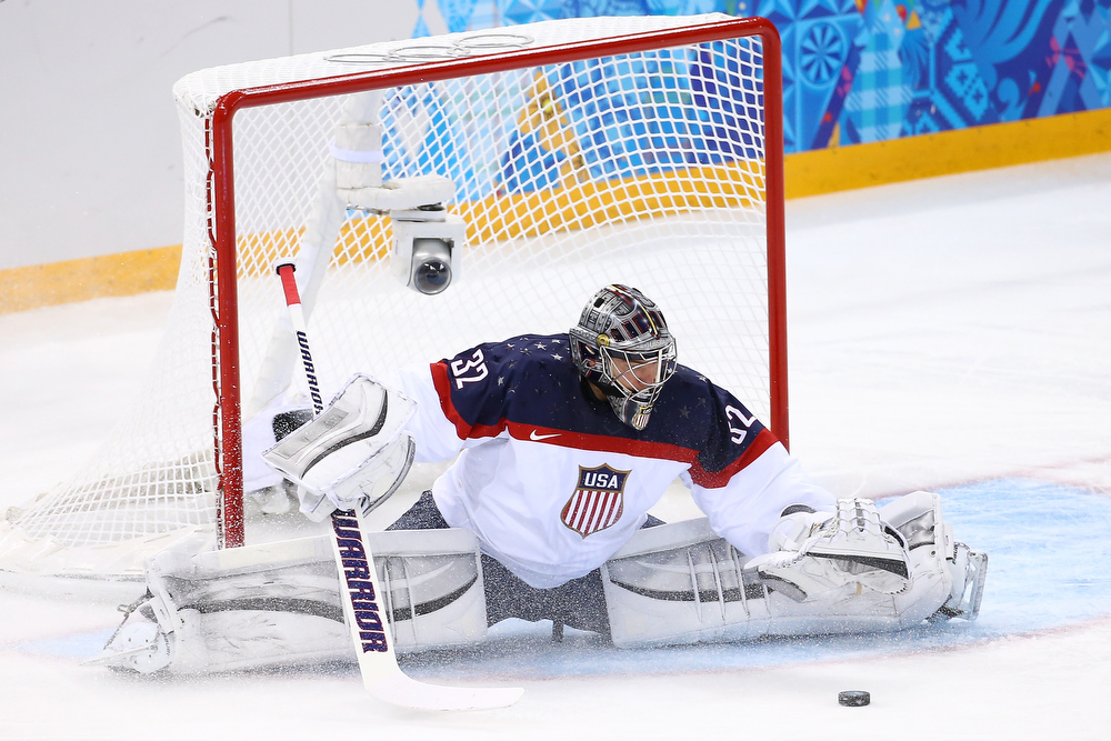 . Jonathan Quick #32 of United States saves a goal against Slovakia during the Men\'s Ice Hockey Preliminary Round Group A game on day six of the Sochi 2014 Winter Olympics at Shayba Arena on February 13, 2014 in Sochi, Russia.  (Photo by Streeter Lecka/Getty Images)