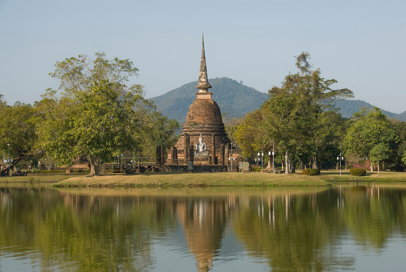 Panoramic shot of Buddha statue in Wat Sa Si - Sukhothai, Thailand
