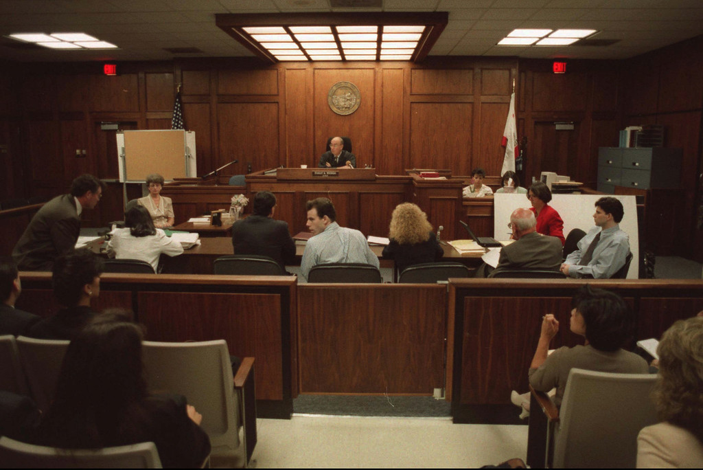 . Erik Menendez, center, and his brother Lyle, far right, sit with their attorneys during the opening statements of their retrial in Van Nuys, Calif., Wednesday, Oct. 11, 1995.  (AP Photo/Gus Ruelas, pool)