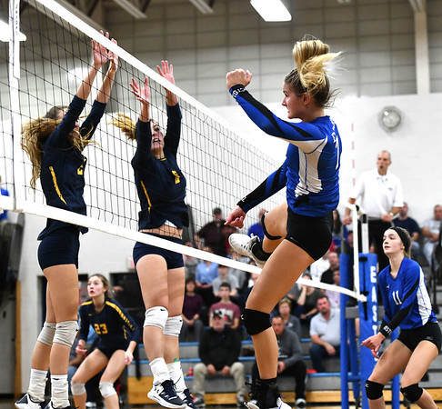 10/23/2019 Mike Orazzi | StaffrBristol Eastern's Zoe Lowe (7) against RHAM during girls volleyball at Bristol Eastern on Wednesday night.
