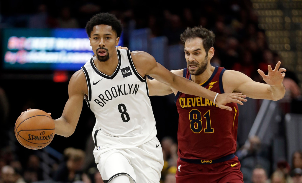 . Brooklyn Nets\' Spencer Dinwiddie (8) drives against Cleveland Cavaliers\' Jose Calderon (81) during the first half of an NBA basketball game, Wednesday, Nov. 22, 2017, in Cleveland. (AP Photo/Tony Dejak)