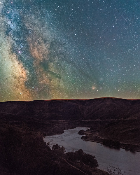 """4 - After suffering damage from the 2018 Substation fire the Deschutes River surrounding area looked reminiscent of an alien landscape.  As I walked along the river in the dry heat of summer I found every step kicked up a small plume of ash making it """"interesting"""" to breathe. I knew the Milky Way would line up with the twist in the river for just a short time period and took advantage of a cloudless and moonless night."""