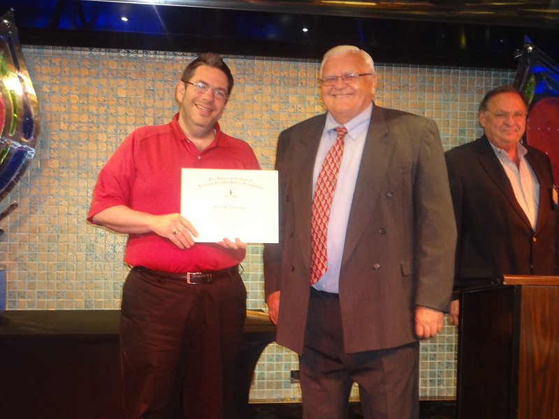 David Torchinsky recieves his certificate for joining the American College of Attorney-CPAs.