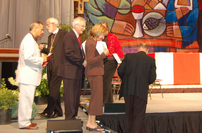 The four officers of the ELCA rehearsing opening worship.