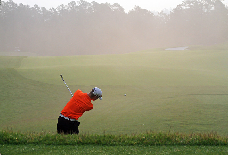Jordan Niebrugge of Mequon, WI sends a tee shot into the morning fog during the championship match of the 111th Western Amateur at The Alotian Club in Roland, AR. (WGA Photo/Ian Yelton)