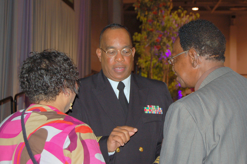 Ava Odom Martin and the Rev. Walter May speak to Commander Harry Griffith, U.S. Navy, Chaplain Corps.