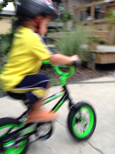 Luca loves riding his two wheeler sans training wheels.