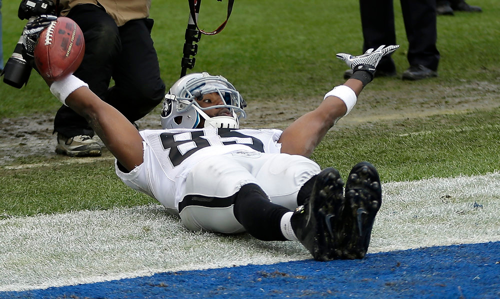 Description of . Oakland Raiders wide receiver Darrius Heyward-Bey motions to the officials after a touchdown catch in the end zone against the San Diego Chargers during the first half of an NFL football game Sunday, Dec. 30, 2012, in San Diego. (AP Photo/Lenny Ignelzi)