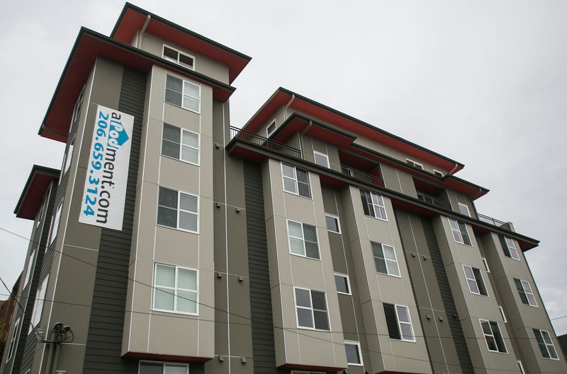 """. The Strada aPodment building which houses low cost micro apartments in Seattle, Washington is seen in this picture taken May 12, 2013. Rent for apartments in the building start at $595 per month.  Tiny apartments are cropping up in major cities around the country to meet the demand of people who are short on cash but determined to live in areas with otherwise pricey rents. Micros, also known as \""""hostel-style\"""" apartments, usually offer less than 200 square feet (18.5 square metres) including private bathrooms, and they typically come furnished, sometimes with built-in beds and other amenities to save space.    REUTERS/Nick Adams"""