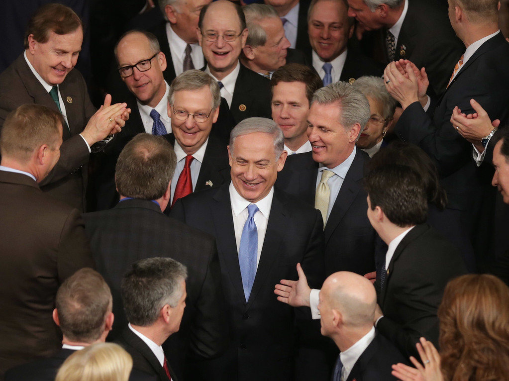 . Israeli Prime Minister Benjamin Netanyahu is greeted by members of Congress as he arrives to speak during a joint meeting of the United States Congress in the House chamber at the U.S. Capitol March 3, 2015 in Washington, DC. At the risk of further straining the relationship between Israel and the Obama Administration, Netanyahu warned members of Congress against what he considers an ill-advised nuclear deal with Iran.  (Photo by Chip Somodevilla/Getty Images)