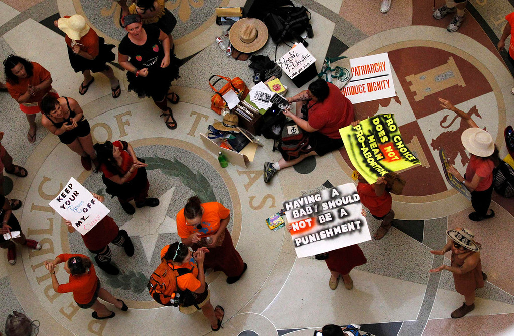 . Protesters rally inside the capitol building at a protest before the start of a special session of the Legislature in Austin, Texas July 1, 2013. When the Texas Legislature convenes on Monday for a second special session, the Republican majority will seek to do what it couldn\'t pull off in the first: Pass sweeping abortion restrictions.  REUTERS/Mike Stone