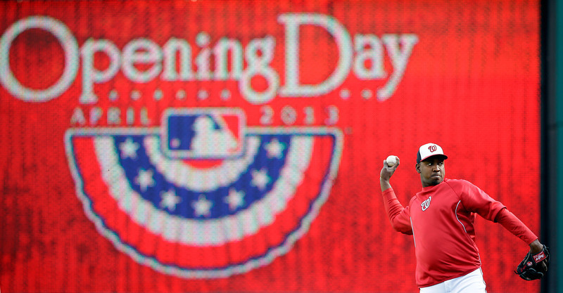 . Washington Nationals relief pitcher Rafael Soriano warms up before an opening day baseball game against the Miami Marlins in Washington, on Monday, April 1, 2013.  (AP Photo/Alex Brandon)