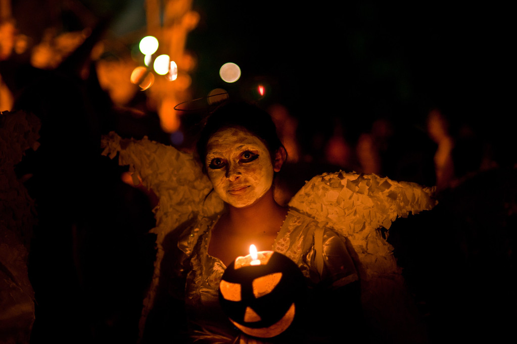 ". A young reveller takes part in a parade called ""La Calabiuza\"" on November 1, 2013, on the eve of the Day of the Dead in Tonacatepeque, 20 kms (13 miles) north of San Salvador, El Salvador. During the celebration, the residents of Tonacatepeque, originally an indigenous community, recall the characters of the mythology of Cuscatlan --pre-Columbian west and central regions of El Salvador-- and their dead relatives. Jose CABEZAS/AFP/Getty Images"