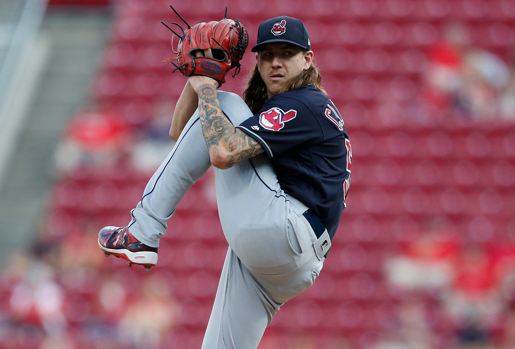 . Cleveland Indians starting pitcher Mike Clevinger throws against the Cincinnati Reds during the first inning of a baseball game, Monday, Aug. 13, 2018, in Cincinnati. (AP Photo/Gary Landers)