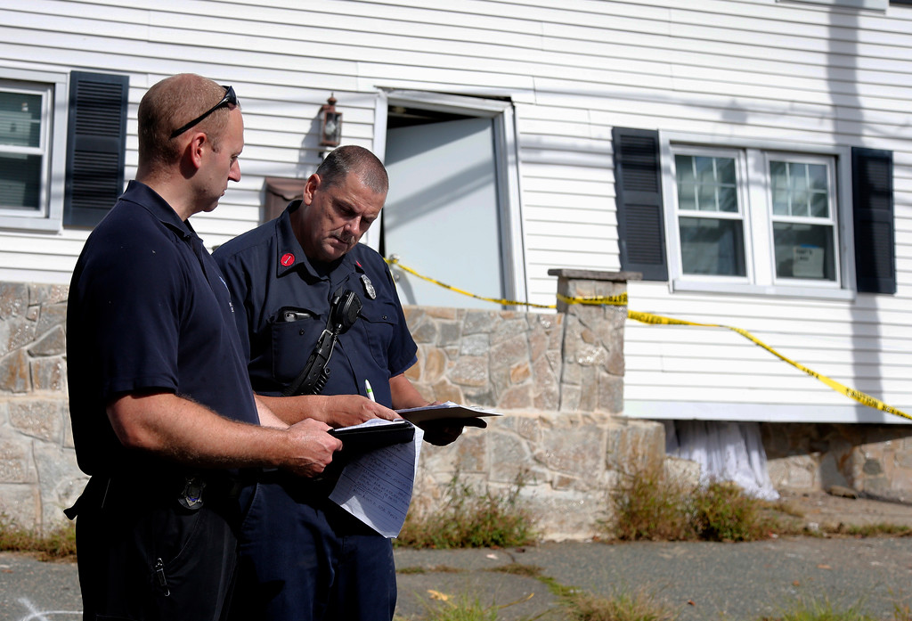 . Fire inspectors take notes outside a house that was blown off its foundation on Kingston Street in Lawrence, Mass., Friday, Sept. 14, 2018. Multiple houses were damaged Thursday afternoon from gas explosions and fires triggered by a problem with a gas line that feeds homes in several communities north of Boston. (AP Photo/Mary Schwalm)