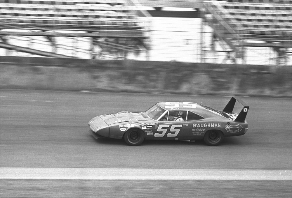 Description of . Tiny Lund of Cross, S.C., drives his 70 Dodge Daytona on the track of the Daytona International Speedway for a test run February 7, 1970.  (AP Photo)