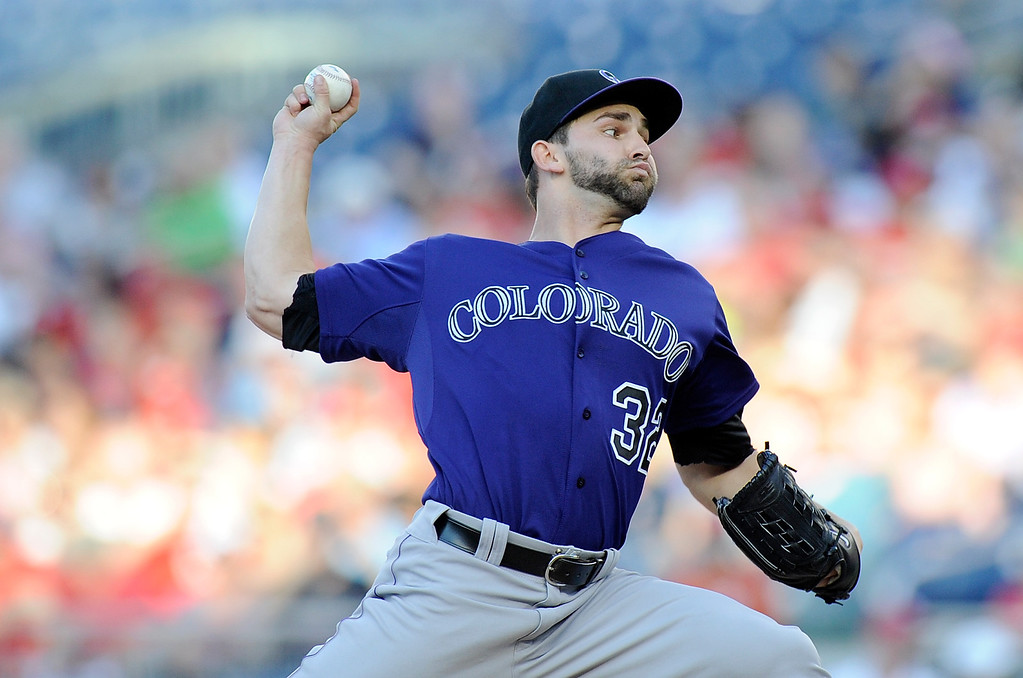 . Tyler Chatwood #32 of the Colorado Rockies pitches in the first inning against the Washington Nationals at Nationals Park on June 21, 2013 in Washington, DC.  (Photo by Greg Fiume/Getty Images)