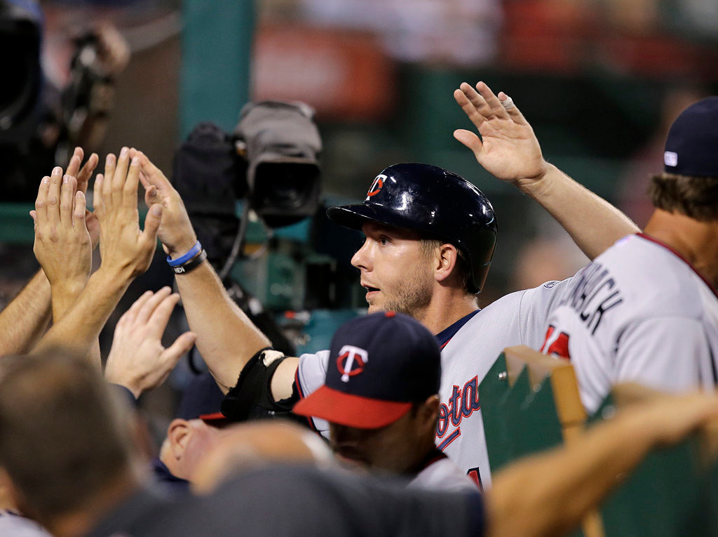 . Minnesota Twins\' Clete Thomas celebrates his home run with teammates during the fourth inning of a baseball game against the Los Angeles Angels on Monday, July 22, 2013, in Anaheim, Calif. (AP Photo/Jae C. Hong)
