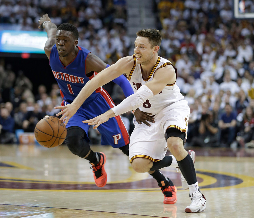 . Cleveland Cavaliers\' Matthew Dellavedova passes around Detroit Pistons\' Reggie Jackson in the first half of Game 2 of the first round of the NBA playoffs on April 20 in Cleveland. Dellavedova led the Cavs in assists with 9, in the team\'s 107-90 win. Cleveland leads the series, 2-0. (AP Photo/Tony Dejak)