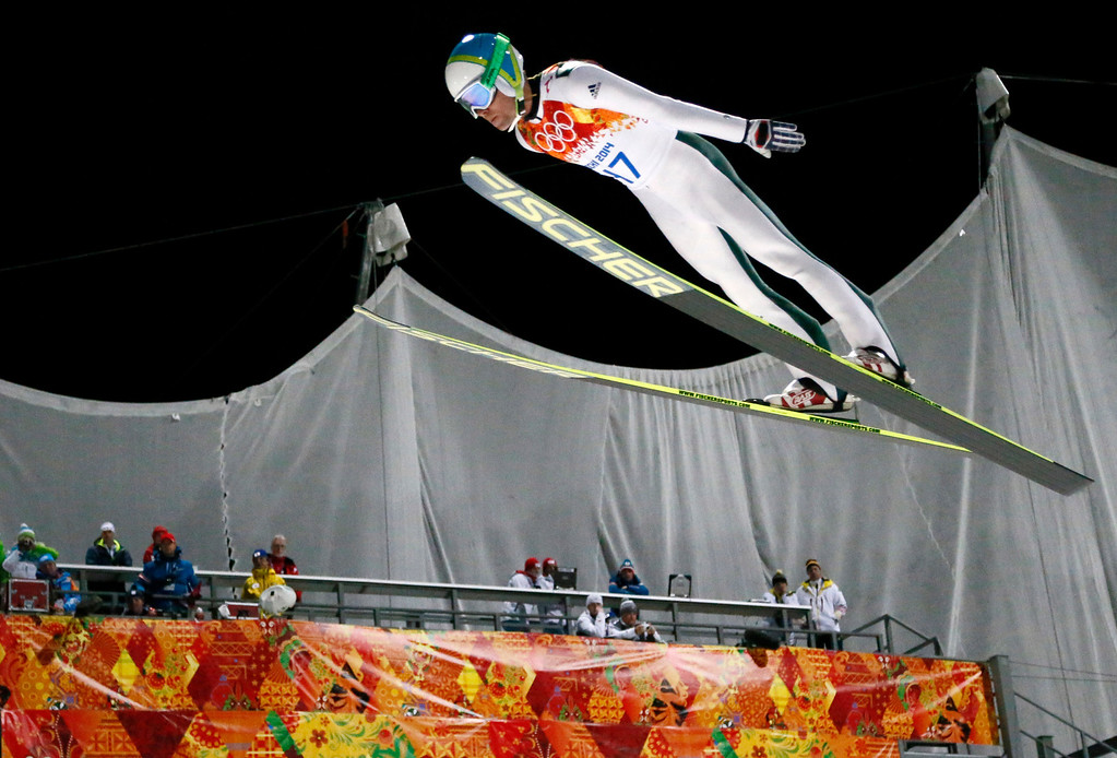 . Slovenia\'s Jernej Damjan makes an attempt during the ski jumping large hill qualification at the 2014 Winter Olympics, Friday, Feb. 14, 2014, in Krasnaya Polyana, Russia. (AP Photo/Dmitry Lovetsky)