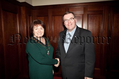 Newry Rotary President Frances Caherty is pictured with Fr Paddy Rushe. R1601013