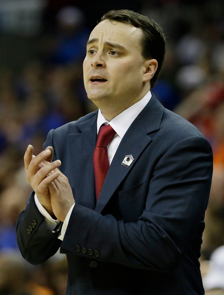. Dayton head coach Archie Miller speaks to players against Florida during the first half in a regional final game at the NCAA college basketball tournament, Saturday, March 29, 2014, in Memphis, Tenn. (AP Photo/Mark Humphrey)