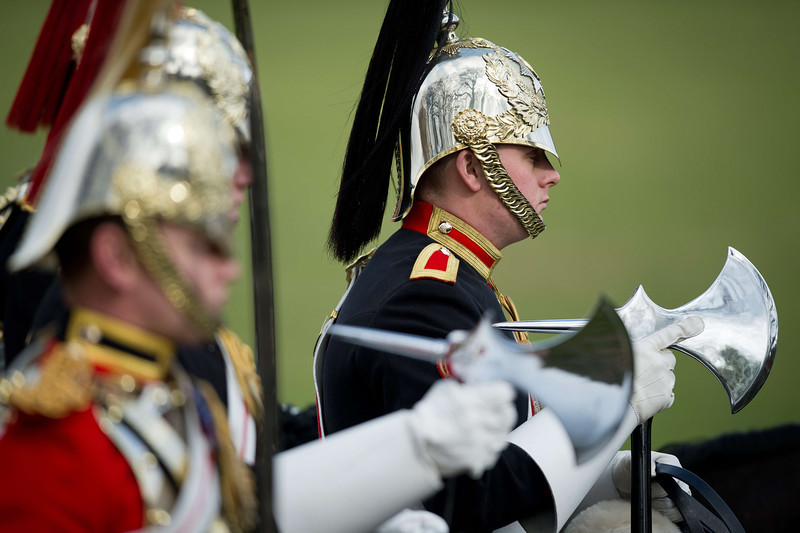 . Farriers carry the ceremonial axes as Members of the Household Cavalry Mounted Regiment take part in the annual inspection in Hyde Park in London on March 20, 2014. The Major General\'s Inspection is the annual validation of the ability of the regiment to conduct State Ceremonial duties for the year.  (LEON NEAL/AFP/Getty Images)