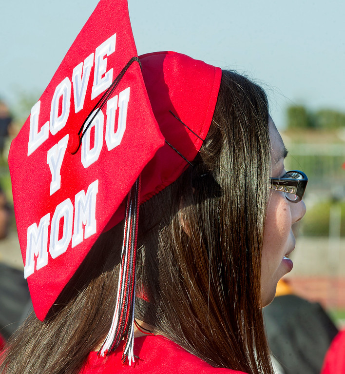 ". Kimberly Caldera with a  message on her cap, \""Love You Mom\"", at Sierra Vista High School Graduation in Baldwin Park Thursday, May 30, 2013.    (Walt Mancini/San Gabriel Valley News)"