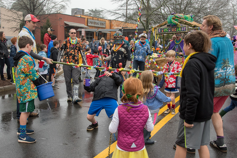 If there is no beach sand, one still has fun doing the limbo marching in the 2018 Mead Rd. Mardi Gras parade