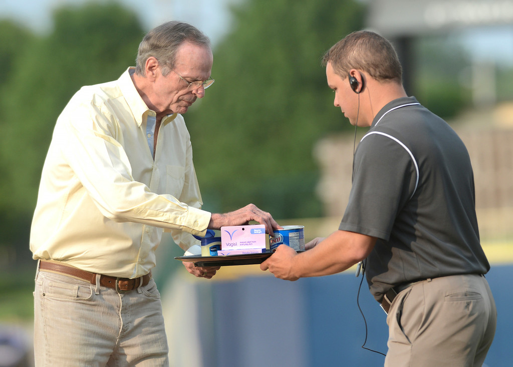 . Duncan Scott/DScott@News-Herald.com Chelcie Ross, who played junkball pitcher Eddie Harris in the movie Major League, selects which ointment to doctor the baseball with before throwing out the first pitch at the Lake County Captains game at Classic Park in Eastlake.