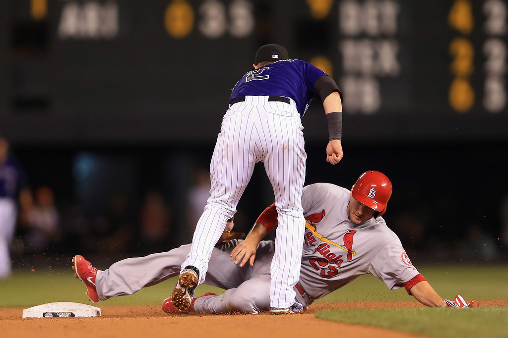 . Shortstop Troy Tulowitzki #2 of the Colorado Rockies tags out David Freese #23 of the St. Louis Cardinals for a double play to end the fifth inning at Coors Field on September 16, 2013 in Denver, Colorado.  (Photo by Doug Pensinger/Getty Images)