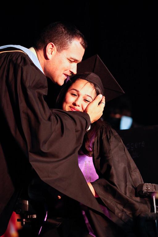 . Annette Herrera gets a hug from Principal Jose Navarro at the Cesar Chavez Learning Academies Social Justice Humanitas Academy graduation in San Fernando, Wednesday, June 5, 2013. (Michael Owen Baker/Staff Photographer)