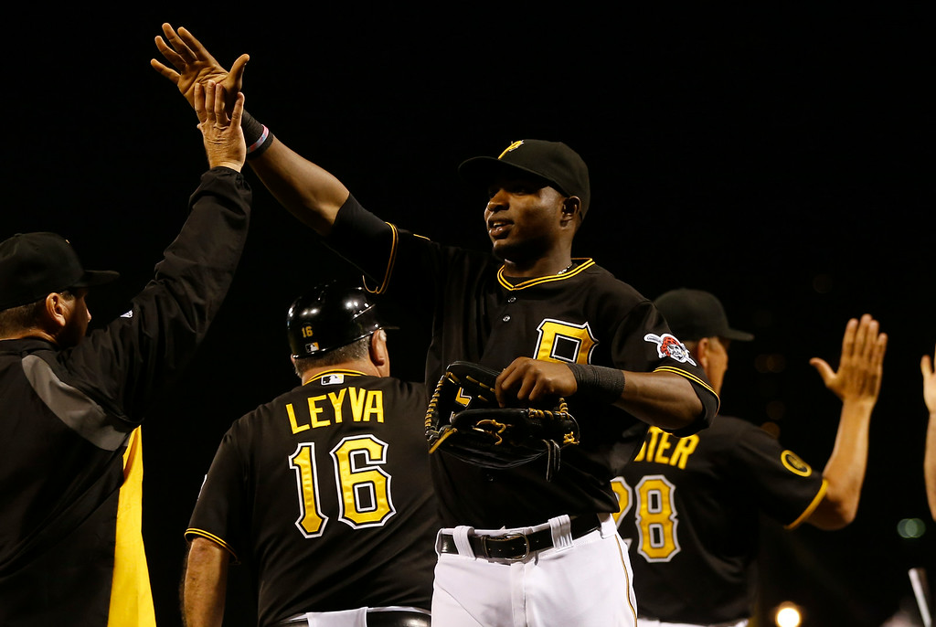 . Pittsburgh Pirates\' Gregory Polanco celebrates with teammates after defeating the Detroit Tigers in the baseball game on Tuesday, Aug. 12, 2014, in Pittsburgh. (AP Photo/Keith Srakocic)