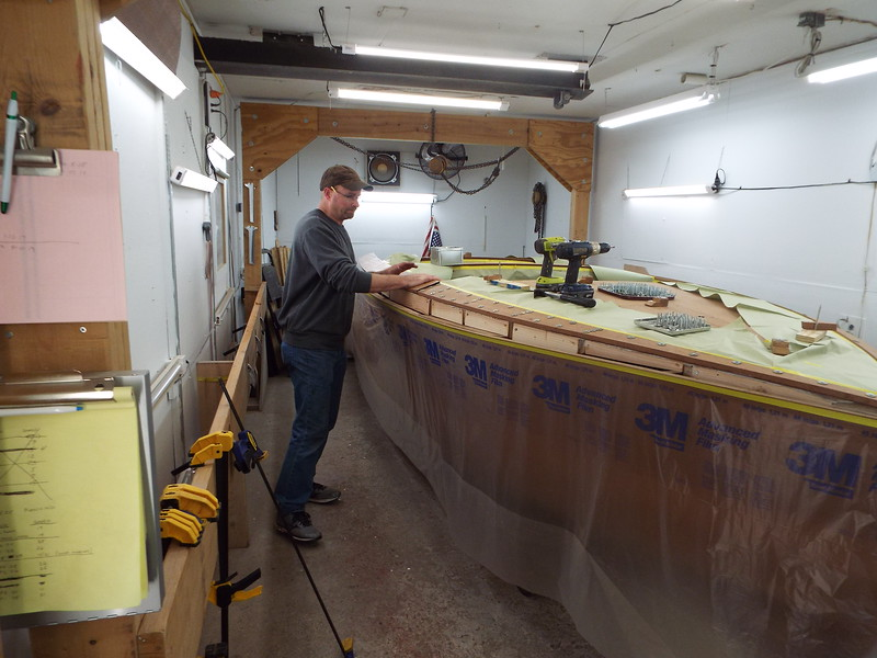 Installing the middle section cover board on the starboard side.