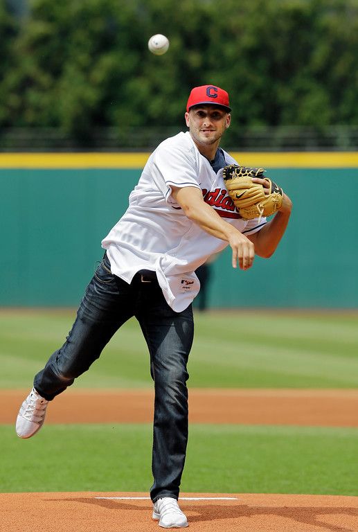 . Cleveland Browns quarterback Brian Hoyer throws a ceremonial pitch before a baseball game between the Chicago White Sox and Cleveland Indians Saturday, July 12, 2014, in Cleveland. (AP Photo/Mark Duncan)