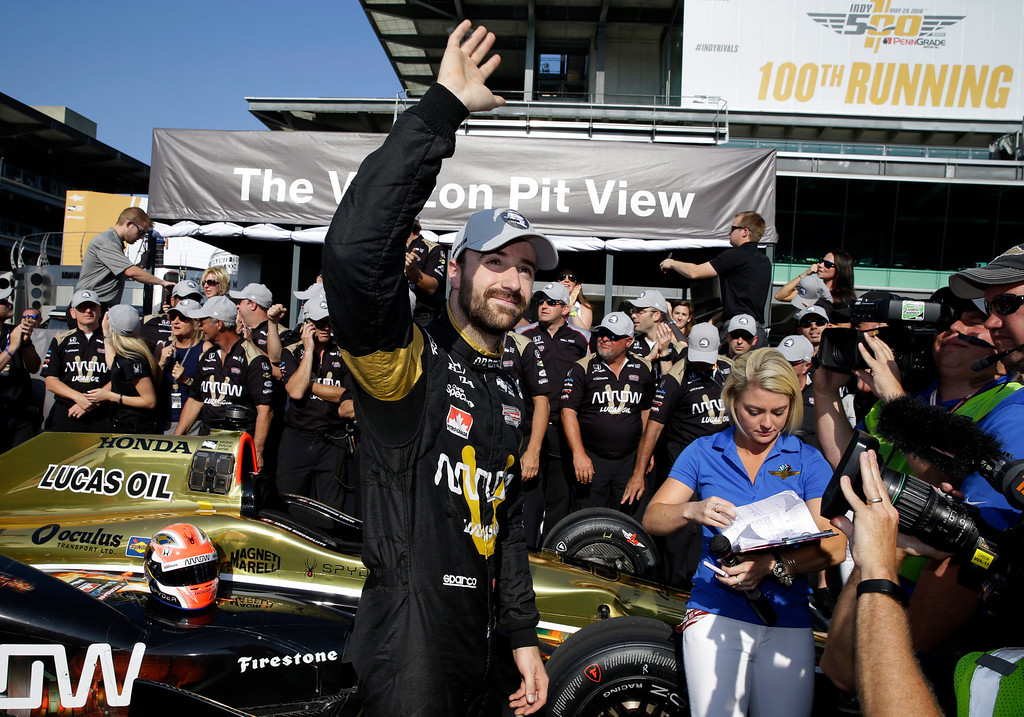 . James Hinchcliffe, of Canada, celebrates winning the pole during qualifications for the Indianapolis 500 auto race at Indianapolis Motor Speedway in Indianapolis, Sunday, May 22, 2016. (AP Photo/Michael Conroy)
