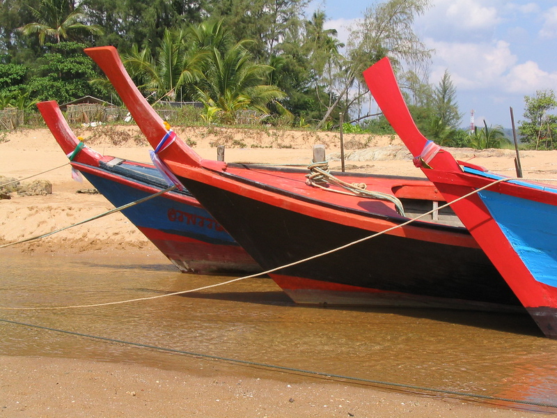Longtail boats docked at high tide