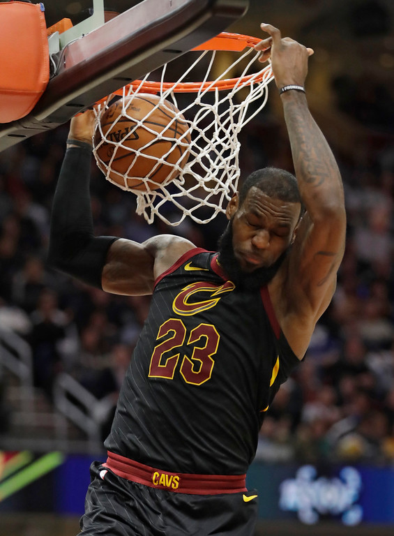 . Cleveland Cavaliers\' LeBron James dunks the ball against the Milwaukee Bucks in the first half of an NBA basketball game, Monday, March 19, 2018, in Cleveland. (AP Photo/Tony Dejak)