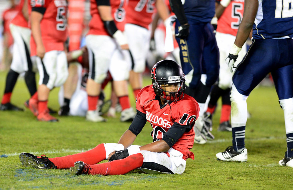 . Pasadena\'s Xavier Hill (10) is taken down in the fourth quarter during the annual Turkey Tussle Friday night, November 8, 2013 at the Rose Bowl in Pasadena. Muir defeated Pasadena 32-21.(Photo by Sarah Reingewirtz/Pasadena Star-News)