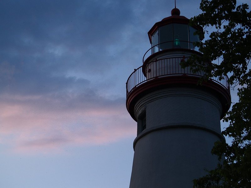 Light pink clouds of the sunset behind the lighthouse, looking north.